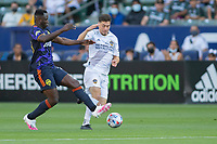 CARSON, CA - JUNE 19: Jorge Villafana #19 of the Los Angeles Galaxy turns with the ball during a game between Seattle Sounders FC and Los Angeles Galaxy at Dignity Health Sports Park on June 19, 2021 in Carson, California.