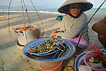 Asia, Vietnam, Nha Trang. Selling and preparing fresh sea food at Nha Trang's beach.
