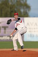 Cameron McVey #28 of the Salem-Keizer Volcanoes pitches against the Eugene Emeralds at Volcanoes Stadium on July 27, 2014 in Keizer, Oregon. Salem-Keizer defeated Eugene, 9-1. (Larry Goren/Four Seam Images)
