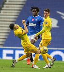 25.10.2020 Rangers v Livingston: Calvin Bassey clears the ball and hits Jason Holt with the ball square in the face cutting his ltp