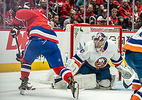 WASHINGTON, DC - JANUARY 31: Semyon Varlamov #40 of the New York Islanders  tracks Alex Ovechkin #8 of the Washington Capitals during a game between New York Islanders and Washington Capitals at Capital One Arena on January 31, 2020 in Washington, DC.