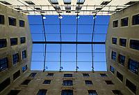 Blue sky as seen from a courtyard inside a building, Marseille, France.