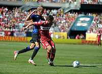 Chicago Fire defender Gonzalo Segares (13) shields Manchester United midfielder Gabriel Obertan (26) from the ball.  Manchester United defeated the Chicago Fire 3-1 at Soldier Field in Chicago, IL on July 23, 2011.