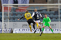 20th February 2021; Dens Park, Dundee, Scotland; Scottish Championship Football, Dundee FC versus Queen of the South; Willie Gibson of Queen of the South shoots and scores for1-3 in the 78th minute