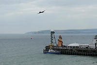 BNPS.co.uk (01202 558833)<br /> Pic: Graham Hunt/BNPS<br /> Date: 2nd September 2021.<br /> <br /> The Dakota of the Battle of Britain memorial flight passes by the pier on day 1 of Bournemouth Air Festival in Dorset on a warm overcast day.