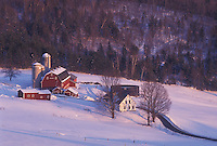 Vermont, VT, Scenic view of Hillside Acres Farm with a red barn in the snow in winter in Barnet.