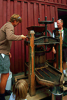 Vintage Basket Apple Press (built 1867) - Man demonstrating the Working of an Old Juice Maker