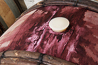Bung hole with stopper. Oak barrel aging and fermentation cellar. Domaine Gravallon Lathuiliere, Morgon, Beaujolais, France