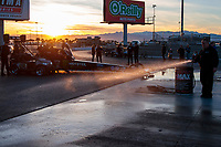 Jan 30, 2020; Las Vegas, NV, USA; Water is sprayed into the burnout box in front of NHRA top fuel driver Brittany Force during PRO testing at The Strip at Las Vegas Motor Speedway. Mandatory Credit: Mark J. Rebilas-USA TODAY Sports