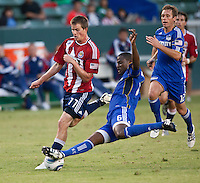 Chivas USA forward Justin Braun (17) gets tackled by KC Wizard defender Shavar Thomas (6) during the second half of the game between Chivas USA and the Kansas City Wizards at the Home Depot Center in Carson, CA, on September 19, 2010. Final score Chivas USA 0, Kansas City Wizards 2.