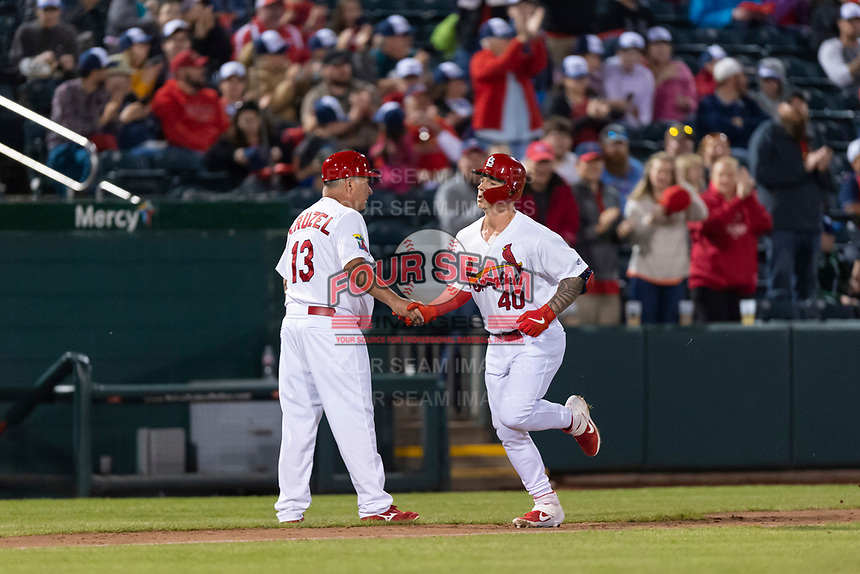 Springfield Cardinals left fielder Tyler O'Neill (40) is congratulated by manager Joe Kruzel (13) after a home run during a rehab assignment in a Texas League game against the Amarillo Sod Poodles on April 25, 2019 at Hammons Field in Springfield, Missouri. Springfield defeated Amarillo 8-0. (Zachary Lucy/Four Seam Images)