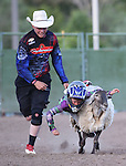 Nathan, of Carson City, competes in the Mutton Bustin' portion of the Smackdown Tour Bull Riding event at Fuji Park in Carson City, Nev., on Saturday, June 7, 2014.<br /> Photo by Cathleen Allison