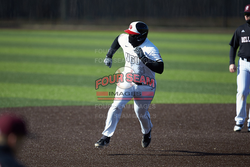 Jordan Holladay (21) of the North Greenville Crusaders hustles towards third base against the Bellarmine Knights at Ashmore Park on February 7, 2020 in Tigerville, South Carolina. The Crusaders defeated the Knights 10-2. (Brian Westerholt/Four Seam Images)