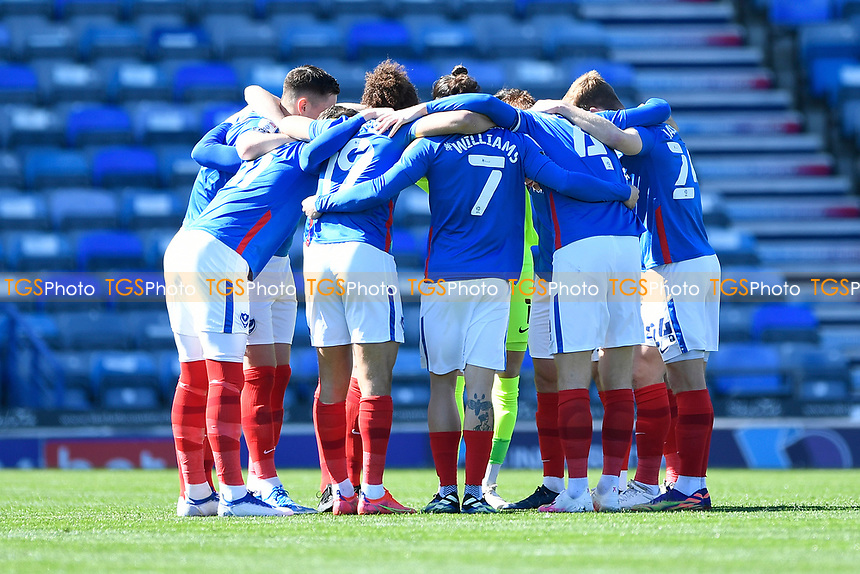 `p` players have a team huddle prior to kick off during Portsmouth vs Rochdale, Sky Bet EFL League 1 Football at Fratton Park on 2nd April 2021