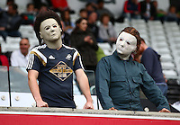 Fans in Halloween themed fancy dress during the Barclays Premier League match between Swansea City and Arsenal played at The Liberty Stadium, Swansea on October 31st 2015