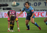 Blue's Langi Veainu watches the ball bounce of the stretching Natahlia Moors during the Super Rugby Women match between the Blues and Chiefs at Eden Park in Auckland, New Zealand on Saturday, 1 May 2021. Photo: Dave Lintott / lintottphoto.co.nz