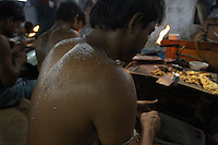 Artisanal gold smiths in Kolkata (Calcutta). These guys make about 3-400 USD a month at the top end.  They live in the workplace. At night they move the worktables aside and sleep on the floor and there are a few other places for them to crowd in to......BUT... you have to be careful with cultural stigmas.  These guys are all very kind to each other, they are from the same village.  They rotate who goes out for food, for tea.  They take care of each other and they NEED each other.  When one of them goes back to the village, he carries the money from all of them.  When he comes back he brings things to them from all of their families...The goldsmiths are give 102.6 grams of gold and are expected to return 100 grams of jewelry.  The average waste for 100 grams is 1.3 grams.  So the owner of the factory tells them he wants a 20 gram piece of jewelry and they have to figure out how to make it that weight and keep to the design they are given...