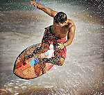 Body boarders and skim boarders do all sorts of tricks of the shores of Sandy's Beach in Honolulu, Hi,