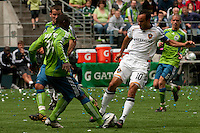 Jhon Hurtado of the Seattle Sounders fights for the ball with Landon Donovan of the LA Galaxy at Quest Field on May 10, 2009. The Sounders and Galaxy played to a 1-1 draw.