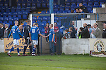 Lancaster City 0 FC Halifax Town 3, 15/10/2011, Giant Axe, FA Cup Third Qualifying Round. Home team players making their way off the pitch at the end of the match as Lancaster City (in blue) play against FC Halifax Town in an FA Cup third qualifying round match at Giant Axe stadium. The visitors, who play two leagues above their hosts in the English football pyramid, won the ties by three goals to nil, watched by a crowd of 646 spectators. Lancaster City were celebrating their centenary in 2011, although there was a dispute over the exact founding date over the club known as Dolly Blue. Photo by Colin McPherson.