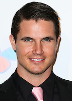LOS ANGELES, CA, USA - OCTOBER 11: Robbie Amell arrives at the Children's Hospital Los Angeles' Gala Noche De Ninos 2014 held at the L.A. Live Event Deck on October 11, 2014 in Los Angeles, California, United States. (Photo by Xavier Collin/Celebrity Monitor)
