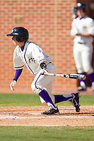 Zach Hubbard #1 of the High Point Panthers follows through on his swing against the Dayton Flyers at Willard Stadium on February 26, 2012 in High Point, North Carolina.    (Brian Westerholt / Four Seam Images)
