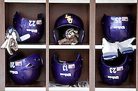 LSU Tigers baseball helmet rack at NCAA Super Regional baseball game on June 9, 2012 at Alex Box Stadium in Baton Rouge, Louisiana. LSU defeated Stony Brook 5-4 in 12 innings. (Andrew Woolley/Four Seam Images)