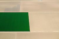 green rectangular field amoung dirt fields