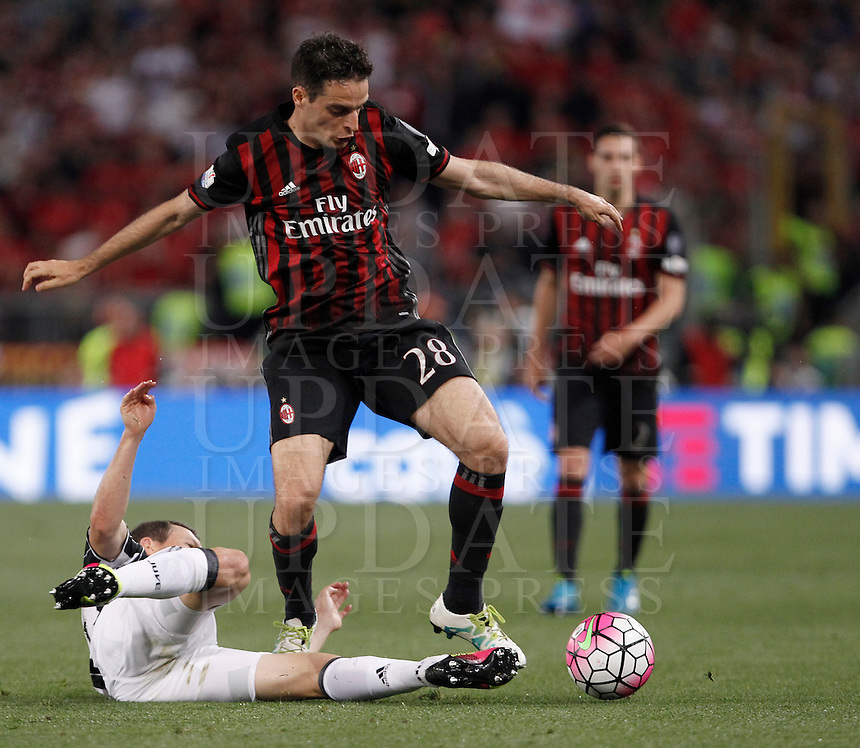 Calcio, finale Tim Cup: Milan vs Juventus. Roma, stadio Olimpico, 21 maggio 2016.<br /> AC Milan's Giacomo Bonaventura, right, is challenged by  Juventus' Stephan Lichsteiner during the Italian Cup final football match between AC Milan and Juventus at Rome's Olympic stadium, 21 May 2016.<br /> UPDATE IMAGES PRESS/Isabella Bonotto