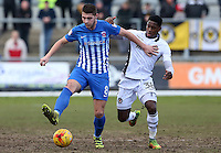 Brad Walker of Hartlepool United is challenged by Mitchell Rose of Newport County during the Sky Bet League Two match between Newport County and Hartlepool United at Rodney Parade, Newport, Wales, UK. Saturday 28 January 2017