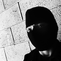 A member of the specialized Police anti-gang unit (Unidad Antipandillas) poses for a picture on the police base before leaving for an operation in San Salvador, El Salvador, 19 December 2013. The anti-gang force, comprising of 300 officers, is part of a new security policy, launched by the government with a goal to fight directly the major street gangs (Mara Salvatrucha and 18th Street Gang) and reduce the high level of violence in the country, caused mainly by the gang criminal activities.