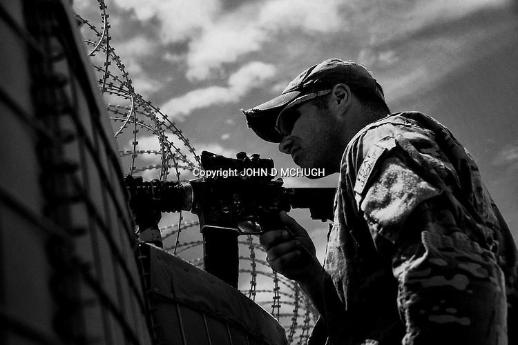 1 Platoon, Delta Co, 1-66, 4th Infantry Division, rebuild a checkpoint in Arghandab Valley, Kandahar, 28 April 2011. (John D McHugh)
