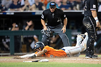 Auburn Tigers shortstop Will Holland (17) slides head first at home during Game 4 of the NCAA College World Series against the Mississippi State Bulldogs on June 16, 2019 at TD Ameritrade Park in Omaha, Nebraska. Mississippi State defeated Auburn 5-4. (Andrew Woolley/Four Seam Images)