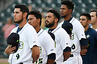 Columbia Fireflies players stand for the national anthem before a game against the Charleston RiverDogs on Tuesday, August 28, 2018, at Spirit Communications Park in Columbia, South Carolina. Columbia won, 11-2. (Tom Priddy/Four Seam Images)