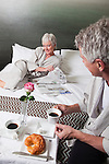 USA, California, Mill Valley, Couple relaxing on bed with breakfast