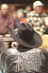 Doyle Brunson wears his WTP jacket during play.