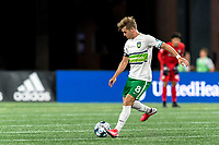 FOXBOROUGH, MA - AUGUST 26: Aaron Walker #8 of Greenville Triumph SC passes the ball during a game between Greenville Triumph SC and New England Revolution II at Gillette Stadium on August 26, 2020 in Foxborough, Massachusetts.