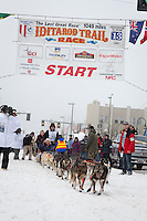 Louie Ambrose and team leave the ceremonial start line at 4th Avenue and D street in downtown Anchorage during the 2013 Iditarod race. Photo by Jim R. Kohl/IditarodPhotos.com