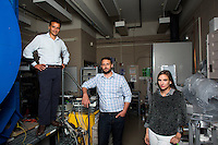 Seen here in the Space Propulsion Laboratory, lab director Dr. Paulo Lozano (left), and Ph.D. candidates Natalya Brikner and Louis Perna (center) have been working on the ion Electrospray Propulsion System (iEPS) for CubeSats at MIT in Cambridge, Massachusetts, USA.  The device is used to maneuver a 10cm cubic satellite in space. Brikner and Perna have formed a company, Accion Systems Incorporated, to commercialize the research. Brikner, graduating in Winter 2014, is CEO of the company, and Perna is co-founder. The research at MIT was done under Space Propulsion Lab director Paulo Lozano, professor in MIT's Department of Aeronautics and Astronautics.