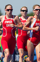 24 JUL 2014 - GLASGOW, GBR - Vicky Holland (ENG) (centre) from England follows team mate Jodie Stimpson (left) and Kirsten Sweetland (CAN) (right) from Canada as they start their second run lap during the elite women's 2014 Commonwealth Games triathlon in Strathclyde Country Park in Glasgow, Scotland (PHOTO COPYRIGHT © 2014 NIGEL FARROW, ALL RIGHTS RESERVED)<br /> *******************************<br /> COMMONWEALTH GAMES <br /> FEDERATION USAGE <br /> RULES APPLY<br /> *******************************