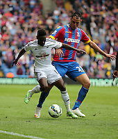 Pictured L-R: Nathan Dyer of Swansea against Marouane Chamakh of Crystal Palace<br /> Re: Premier League match between Crystal Palace and Swansea City at Selhurst Park on Sunday 24 May 2015 in London, England, UK