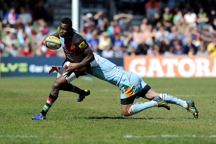 Ugo Monye of Harlequins is tackled by Stephen Myler of Northampton Saints during the Aviva Premiership match between Harlequins and Northampton Saints at the Twickenham Stoop on Saturday 4th May 2013 (Photo by Rob Munro)