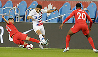 TORONTO, ON - OCTOBER 15: Jonathan Osorio #21 and Cristian Roldan #15 of the United States battle for a loose ball during a game between Canada and USMNT at BMO Field on October 15, 2019 in Toronto, Canada.