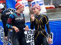 17 JUL 2011 - HAMBURG, GER - Emma Moffatt (AUS) (left) and Erin Densham (AUS) share a joke before the start of the women's Hamburg round of triathlon's ITU World Championship Series .(PHOTO (C) NIGEL FARROW)