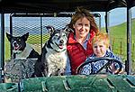 Kristy and son drive the ranch four wheeler, San Luis Obispo, California