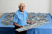 BNPS.co.uk (01202) 558833<br /> Pic: ZacharyCulpin/BNPS<br /> <br /> Pictured: Philip Warren with his brand new model of the Gerald Ford US aircraft carrier<br /> <br /> A master modeller who was inundated with hundreds of rare matchboxes after appealing for donations has used them to build a 3ft long aircraft carrier.<br /> <br /> Now Philip Warren has added the impressive model to his so-called matchbox fleet of miniature ships which have gone on display in an exhibition.<br /> <br /> Mr Warren's 72 year pastime of building model warships had looked as though it had come to an end earlier this year when he ran out of the traditional wooden boxes he used to make the hull and decks.<br /> <br /> But the 90-year-old was sent more than 300 of the lightweight matchboxes made from aspen wood in response to his plea for more.