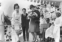 1967 FILE PHOTO - ARCHIVES -<br /> <br /> Presentation of flowers is made to Mrs. Robert Shaw; official Expo hostess; by Yiyi-chit Maung; 24; of Rangoon at yesterday's visit to the fair by Brigadier Tin Pe (right); Burma's trade minister. The ceremony took place in Place des Nations in a chilly wind. The brigadier is wearing a pale pink taung shaw (shoe-length dress); a white Burma jacket and yellow headdress.<br /> <br /> PHOTO :  Norman JAMES - Toronto Star Archives - AQP