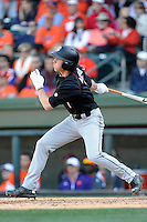 Third baseman DC Arendas (7) of the South Carolina Gamecocks hits in the Reedy River Rivalry game against the Clemson Tigers on March 1, 2014, at Fluor Field at the West End in Greenville, South Carolina. South Carolina won, 10-2.  (Tom Priddy/Four Seam Images)