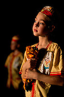 A young performer watches from the wings for her time to dance during the North Carolina Dance production of the Nutcracker at Belk Theatre in Charlotte, NC.