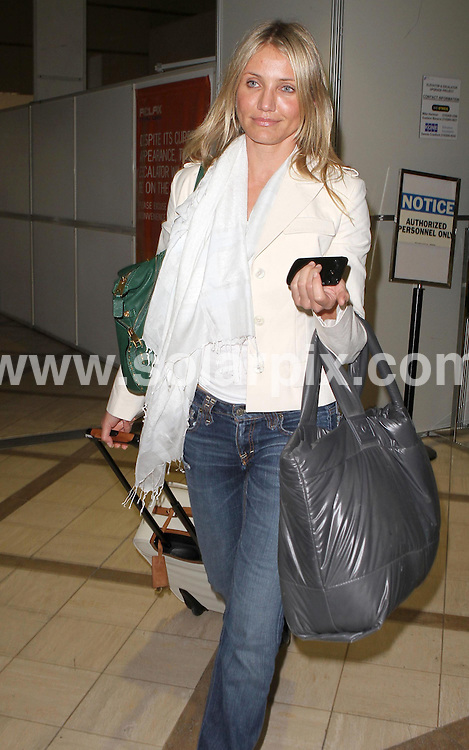 **ALL ROUND PICTURES FROM SOLARPIX.COM**.**SYNDICATION RIGHTS FOR UK AND SPAIN ONLY**.Sexy American blonde actress Cameron Diaz was pictured looking a little tired as she arrived back at LAX airport, in California, USA. 5 June 2010.This pic: Cameron Diaz..JOB REF: 11411 PRT        DATE: 05_06_2010.**MUST CREDIT SOLARPIX.COM OR DOUBLE FEE WILL BE CHARGED**.**MUST NOTIFY SOLARPIX OF ONLINE USAGE**.**CALL US ON: +34 952 811 768 or LOW RATE FROM UK 0844 617 7637**
